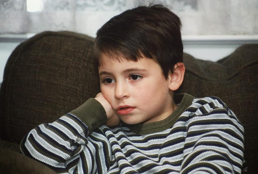 boy sitting on couch